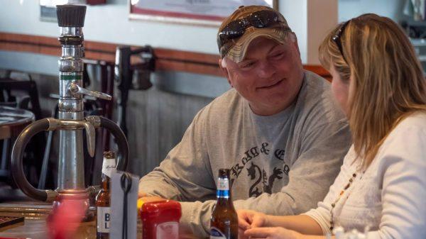 members at the beer tap